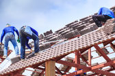 Workers install roof tile for house — Foto Stock