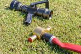 Firefighting equipment on grass — Stock Photo