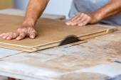 Carpenter use saw to cut wood for make new furniture — Stock Photo