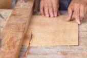 Carpenter using saw — Stock Photo