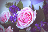 Pink rose with purple bouquet — Foto Stock