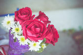 Red rose with purple bouquet — Foto de Stock