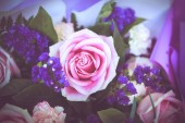 Pink rose with purple bouquet — Stock Photo