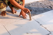 Labor installing tile floor — Stock Photo