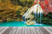 Wonderful waterfall in thailand  with wooden floor — Stock Photo