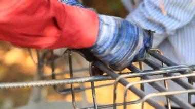 Workers bending steel for construction job — Stock Video