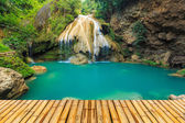 Wonderful waterfall in thailand  with bamboor floor — Stock Photo