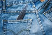 Jeans bag with knife — Stockfoto