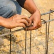 Technician injury from bundle wire steel rod for construction jo — Stock Photo #67552987