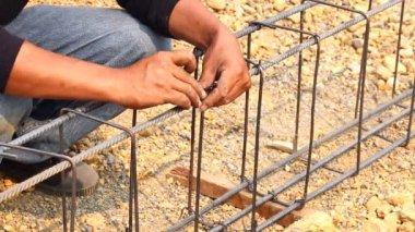 Technician bundle wire steel rod for construction job — Stock Video