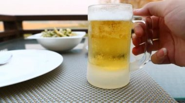 Frosty glass of light beer — Stock Video