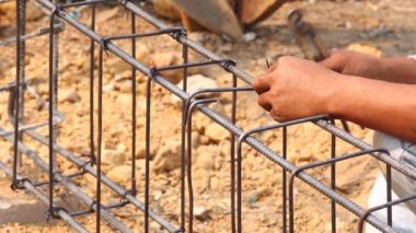 Technician bundle wire steel rod for construction job — 图库视频影像