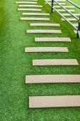 Staircase artificial grass with wooden — Stock Photo