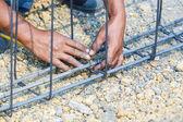 Technician bundle wire steel rod for construction job — Stock Photo