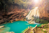 Wonderful waterfall with colorful tree in thailand — Stock Photo