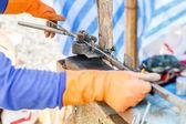 Worker bending steel — Stock Photo