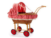 An old vintage childrens doll stroller over a white background — Stock Photo