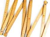 Close up of a carpentry ruler on white background — Stock Photo