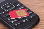 SIM Card over the Phone — Stock Photo