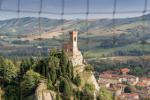 Clock tower through medieval window — Stock Photo