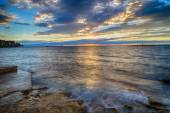Sunset on prefabricated breakwater and lighthouses — Stock Photo