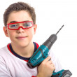Child wearing red goggles and holding a cordless drill — Stock Photo #66098233