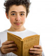 Cute boy reads brown cork blank book smiling — Stock Photo #66101393