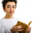 Cute boy reads brown cork blank book smiling — Stock Photo #66101733