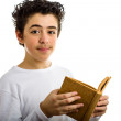 Cute boy reads brown cork blank book smiling — Stock Photo #66101939