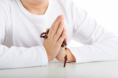 A boy is praying holding Rosary with both hands — ストック写真