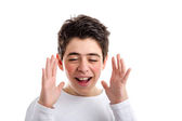 Caucasian boy with acne-prone skin waving open hands along the s — Stock Photo