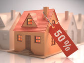 Small house with red label written 50 percent — Foto de Stock