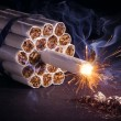 A pack of cigarettes in the form of dynamite ready to explode. — Stock Photo #63301113