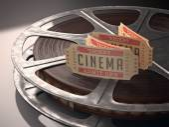 Cinema ticket over rolls of film — Stock Photo