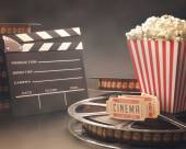 Objects related to the cinema on reflective surface. — Stock Photo