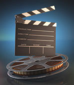 Clapperboard and roll of film — Stock Photo