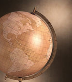 Antique globe with spotty background — Stock Photo