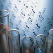 Test tubes with chemical elements inside — Stock Photo