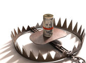 Roll of US one hundred dollars on a bear trap. — Stock Photo