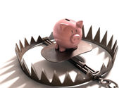 Piggy bank in the bear trap — Stock Photo