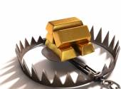 Bear trap with gold bars — Stock Photo