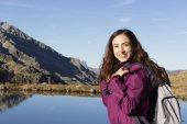 Young hiker woman enjoying nature in autumn — Stock Photo