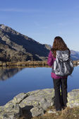 Hiker woman enjoying the mountain landscape in autumn — Stock Photo