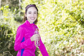 Fitness woman with a water bottle in her hand during sports — Stock Photo