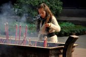 Xindu, China: Woman with Incense Sticks — Stock Photo