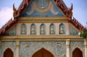 Kanchanaburi, Thailand: Thai Temple Tympanum Buddha Figures — Stock Photo