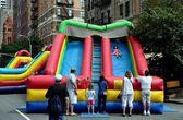 NYC:  Children on Inflated Slide at Street Festival — Stock Photo