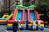 NYC:  Children on Inflated Slide at Street Festival — Foto de Stock