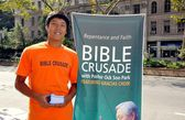 NYC: Young Asian Man working for Bible Crusade — Stock Photo