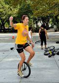 NYC: Woman on Unicycle — Stock Photo